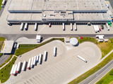 Aerial view of warehouse with trucks. Industrial background. Logistics from above.  - 174962028