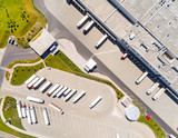 Aerial view of warehouse with trucks. Industrial background. Logistics from above.  - 174962084