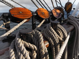 closeup of wooden blocks or pulleys on traditional sailing vessel - 174967825
