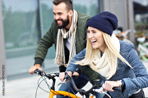 Papiers peints Kiev Young couple riding bikes and having fun in the city