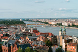 Panoramic view on the Hungarian Parliament Building on the bank of the Danube in Budapest. Sunny evening with clouds - 174968028