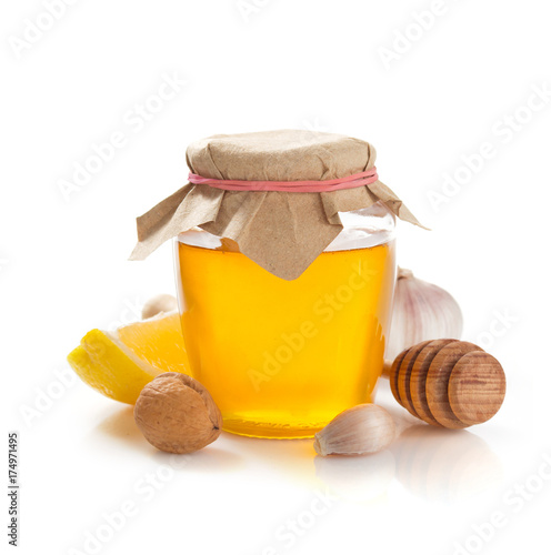 glass jar of honey on white background Poster
