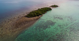 Aerial drone view of small green trees islands in blue sea water - 174974426