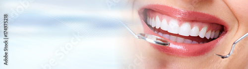Woman teeth with dental instruments