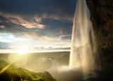 Seljalandsfoss waterfall at sunset, Iceland - 174980086