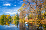 Sunny autumn landscape with blue sky over the lake - 174989453