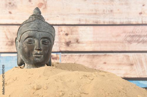 Staande foto Boeddha Buddha in sand