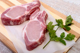 Raw pork chops, spices and basil on cutting board. Ready for cooking. - 174998072
