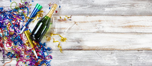 New Year party decorations and champagne on rustic white wood