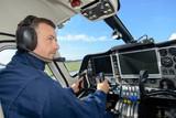 Pilot sat in cab of aircraft