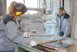 colleagues sanding and varnishing wood in workshop - 175002435