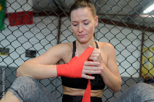 woman martial artist wrapping her hand Poster