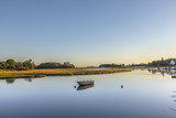 scenic sunrise at the canals in Essex with boat - 175008817