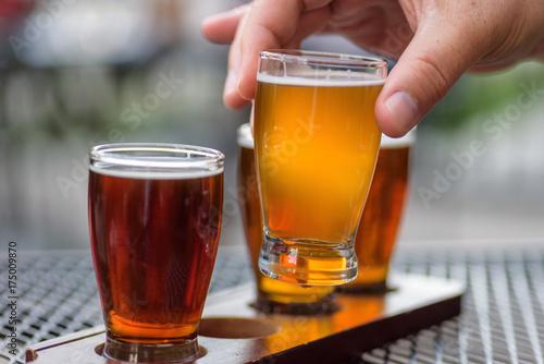 Fototapeta man sampling beer flight