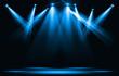 Stage lights. Blue spotlight strike through the darkness.