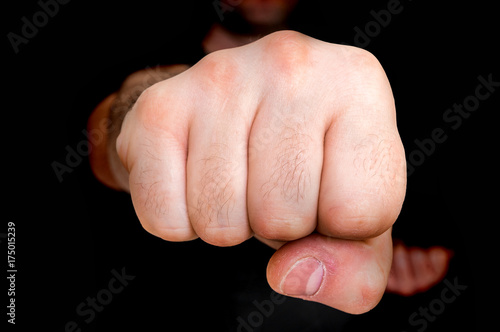 Young boxer showing punch a fist - martial arts concept Poster