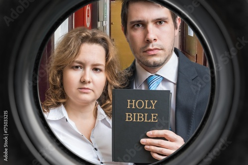 Jehovah witnesses are showing bible behind door Poster