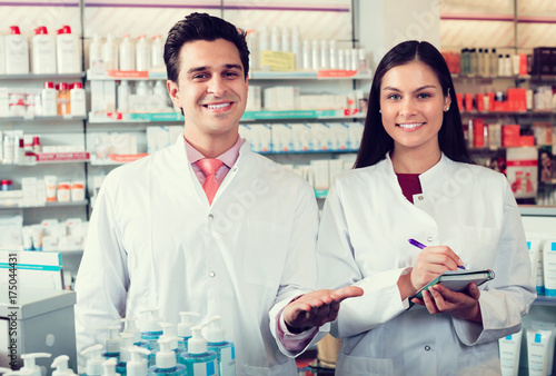 Tuinposter Apotheek pharmacists posing in drugstore