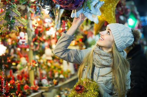 Girl choosing Christmas gifts outdoor.