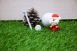 Merry Christmas to golfer with golf ball and decoration