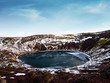 Landscape of Kerio crater frozen lake in Iceland. Geothermal area in winter