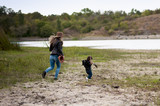 mother catches her daughter near the lake - 175060024