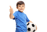 Small boy holding football and making thumb up sign - 175061077