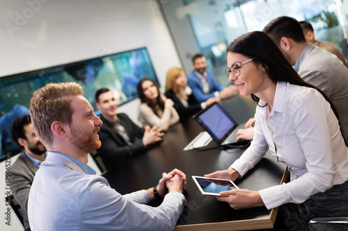 Portrait of business couple in conference room - 175065299