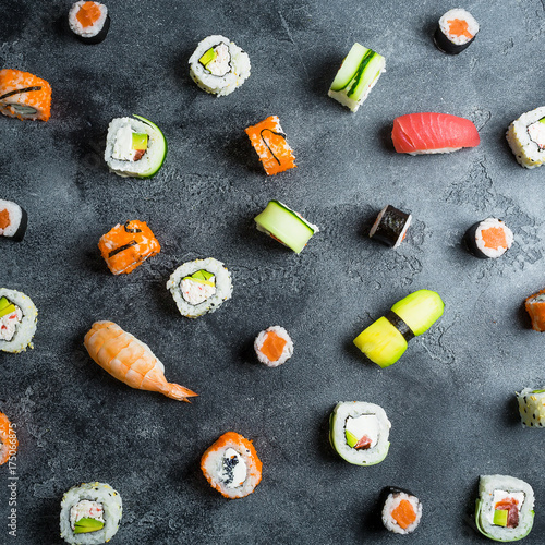 Foto op Canvas Sushi bar Pattern of sushi rolls on a dark background. Japanese food. Flat lay. Top view