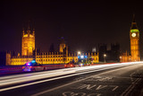 Police Cars and Ambulance on Westminster Bridge, London at Night