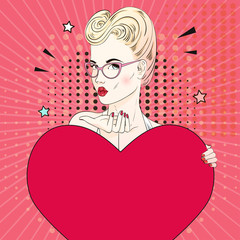 Comic Pop art blonde hair woman send an air kiss in glasses and holds a red heart. Vector illustration.
