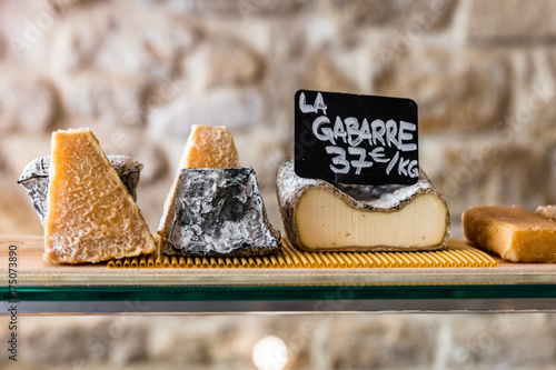 Cheeses on the counter of a small store. Paris, France