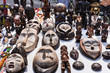 Wooden masks and figures of African culture at the flea market in Paris. France