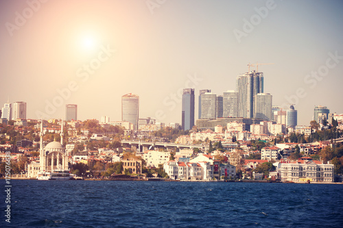 View from Bosphorus of the Istanbul city downtown with skyscrapers at sunset Poster
