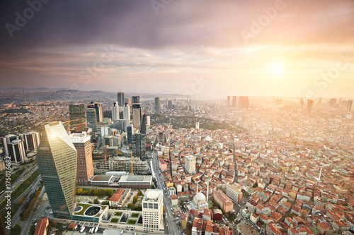 Aerial view of the Istanbul city downtown with skyscrapers at sunset Poster