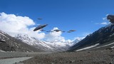 A loop of alien spaceships flying in the Himalayan mountains, for futuristic, fantasy and war game backgrounds.