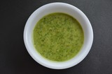 Indian traditional Coriander chutney in a white bowl. - 175093009