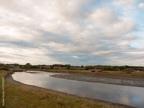 Aluminium Pier lake river through countryside with farm house roof agriculture scene