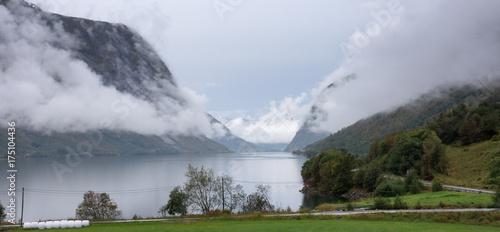 Foto op Canvas Wit Foggy fjord landscape