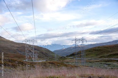 Papiers peints Cappuccino Hydro electric power lines crossing mountainn