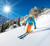 Skier skiing downhill in high mountains - 175106649