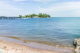 City Island Bronx harbor with boat on pier and sandy beach with ocean - 175106673