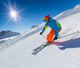 Skier skiing downhill in high mountains - 175107073