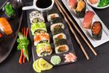 Japanese sushi set on a rustic dark background. - 175110479