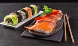 Japanese sushi set on a rustic dark background. - 175110666