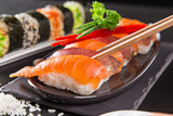Japanese sushi set on a rustic dark background. - 175111058