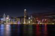 Quadro Hong Kong Island's skyline over Victoria Harbour with lit modern skyscrapers at night in Hong Kong, China. Viewed from Tsim Sha Tsui, Kowloon.