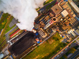 Aerial view of modern combined heat and power plant. Fuming chimney with sulphur removal unit. Heavy industry from above. Power and fuel generation in European Union.  - 175122846