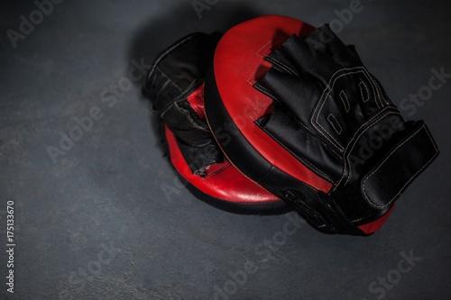Fotobehang Fitness Boxing gloves and focus mitt in fitness studio