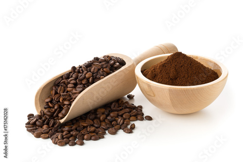 Coffee beans with ground coffee in wooden bowl